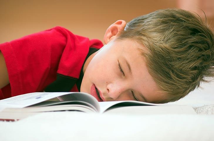 Tired boy student